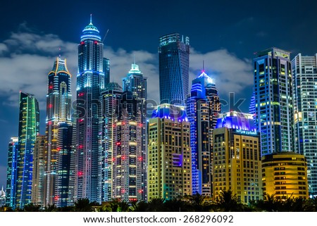DUBAI, UAE - NOVEMBER 13: Modern buildings in Dubai Marina, Dubai, UAE. In the city of artificial channel length of 3 kilometers along the Persian Gulf, taken on 13 November 2013 in Dubai. - stock photo