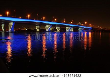 DUBAI, UAE - NOVEMBER 12: Night beauty of Al Makthoom Bridge in  Dubai. UAE. November 12, 2008. Dubai was the fastest developing city in the world between 2002 and 2008. - stock photo