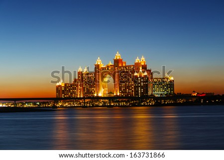 DUBAI, UAE-NOVEMBER 7: Night view Atlantis Hotel on November 7, 2013 in Dubai, UAE. The resort consists of two towers linked by a bridge, with a total of 1539 rooms. - stock photo