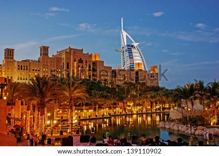 DUBAI, UAE-NOVEMBER 15: Night view of Burj al Arab hotel (7 star, 1999) from territory of Madinat Jumeirah hotel on November 15, 2012 in Dubai, UAE. Madinat Jumeirah - luxury 5 star hotel - stock photo