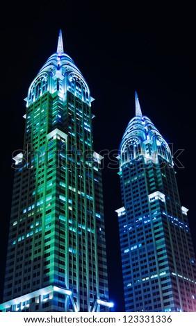 DUBAI, UAE-NOVEMBER 14: Night view of the Chrysler building in Dubai on November 14, 2012. Dubai builds two imitations of NYC Chrysler building. - stock photo