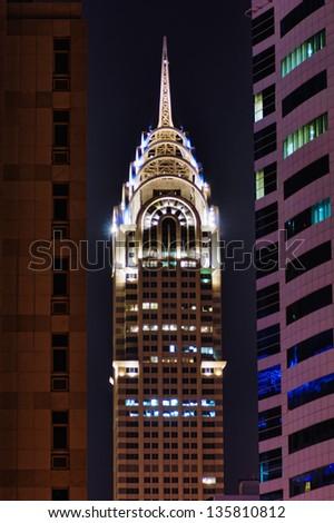 DUBAI, UAE-NOVEMBER 12: Night view of the Chrysler building in Dubai on November 12, 2012.  Dubai builds two imitations of NYC Chrysler building. - stock photo