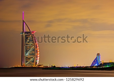 "DUBAI, UAE-NOVEMBER 17: Night view of the world's first seven stars luxury hotel Burj Al Arab ""Tower of the Arabs"" on November 17, 2012 in Dubai. Also known as ""Arab Sail"" - stock photo"