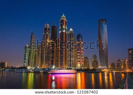 DUBAI, UAE - NOVEMBER 14: Nightlife in Dubai Marina. UAE. November 14, 2012. Dubai is the most expensive city in the Middle East. - stock photo