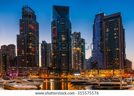 DUBAI, UAE - NOVEMBER 16: Nightlife in Dubai Marina. UAE. November 16, 2012. Dubai was the fastest developing city in the world between 2002 and 2008.