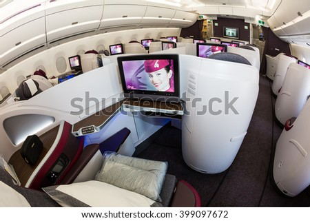 Dubai, UAE - NOVEMBER 08, 2015: Qatar Airways Airbus A350 business class cabin. Qatar Airways business class seats. Qatar Airways luxury business class travel  on November 08, 2015 in Dubai - stock photo