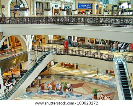 DUBAI, UAE - NOVEMBER 11: Shoppers at Dubai Mall on Nov 11, 2008 in Dubai. At over 12 million sq ft, it is the world's largest shopping mall based on total area and 6th largest by gross leasable area. - stock photo