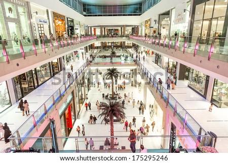 DUBAI, UAE - NOVEMBER 14: Shoppers at Dubai Mall on Nov 15, 2013 in Dubai. At over 12 million sq ft, it is the world's largest shopping mall - stock photo