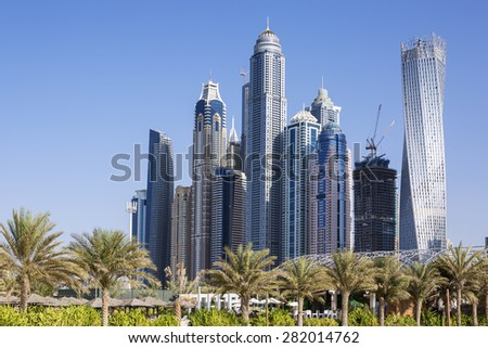 DUBAI, UAE - 28 NOVEMBER 2014: Technology park of Dubai Internet City at sunrise, UAE. Dubai Internet City is created by the government free economic zone for global information technology firms. - stock photo