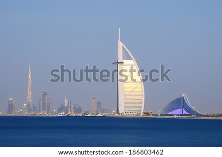 DUBAI, UAE - NOVEMBER 2 :The world's first seven stars luxury hotel Burj Al Arab seen alongside of Jumeirah Beach hotel and Burj Khalifa, November 2, 2012 in Dubai, United Arab Emirates - stock photo