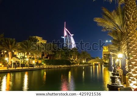 DUBAI, UAE - NOVEMBER 23: View at Burj Al arab hotel from Madinat Jumeirah luxury hotel at night in Dubai, UAE on 23 November 2015 - stock photo