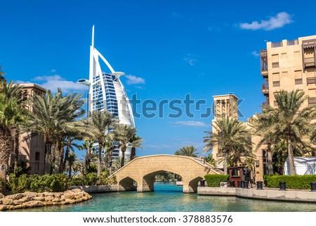 DUBAI, UAE - NOVEMBER 23: View at Burj Al arab hotel from Madinat Jumeirah luxury hotel in a summer day in Dubai, UAE on 23 November 2015 - stock photo