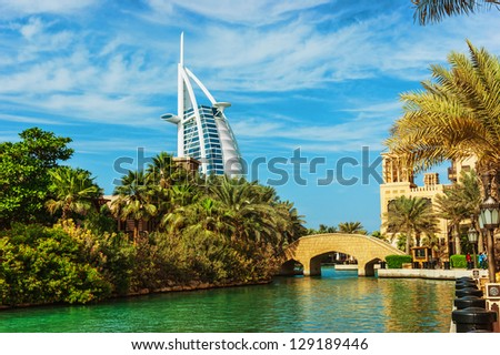 DUBAI, UAE - NOVEMBER 15 View of the hotel Burj Al Arab from Souk Madinat Jumeirah  in Dubai, UAE. Nov 15, 2012. Burj Al Arab is a luxury 7 stars hotel - stock photo