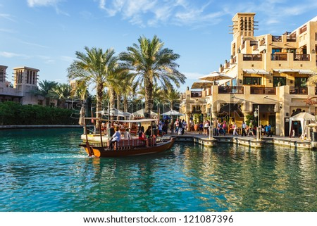 DUBAI, UAE - NOVEMBER 15: View of the  Souk Madinat Jumeirah. Madinat Jumeirah encompasses two hotels and clusters of 29 traditional Arabic houses.  Nov 15, 2012 in Dubai - stock photo