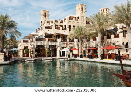 DUBAI, UAE - NOVEMBER 15: Views of Madinat Jumeirah hotel, on November 15, 2012, Dubai, UAE. Madinat Jumeirah - luxury 5 star hotel with own artificial canals and boats. - stock photo