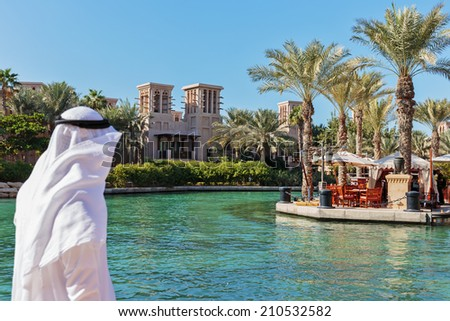 DUBAI, UAE - NOVEMBER 7: Views of Madinat Jumeirah hotel, on November 7, 2013, Dubai, UAE. Madinat Jumeirah - luxury 5 star hotel with own artificial canals and boats. - stock photo