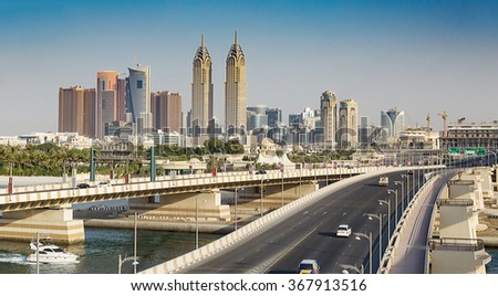 DUBAI, UAE - NOVEMBER 3: Views of the Dubai Marina from the island of Palm Jumeirah, on November 3, 2013, Dubai, UAE. In the city of artificial channel length of 3 kilometers along the Persian Gulf. - stock photo