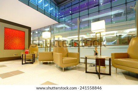 DUBAI, UAE - OCT 17: airport interior on October 17, 2014 in Dubai. Dubai International Airport is an international airport serving Dubai. It is a major airline hub in the Middle East - stock photo