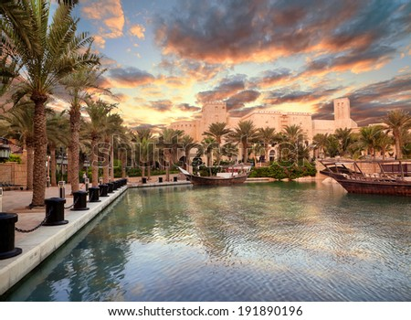 DUBAI, UAE - OCTOBER 25: Beautiful views of Madinat Jumeirah hotel on October 25, 2012 on Dubai, United Arab Emirates. Madinat Jumeirah - luxury 5 star hotel with own artificial canals and boats. - stock photo