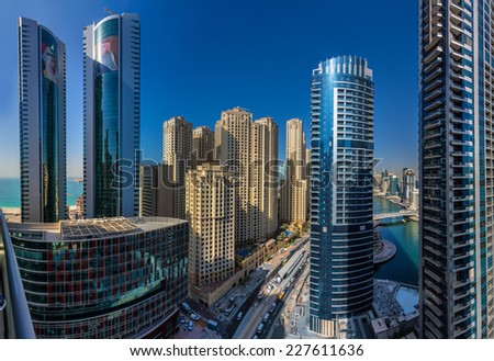 DUBAI, UAE - OCTOBER 21: City scenery of Dubai Marina on October 21, 2014, UAE. Dubai Marina is a district in Dubai with artificial canal skyscrapers who accommodates more than 120,000 people. - stock photo