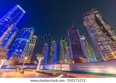 DUBAI, UAE - OCTOBER 9, 2015: Dubai Marina night skyline. The city attracts 13 million people wordwide every year.