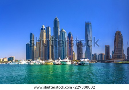 DUBAI, UAE - OCTOBER 18: Modern buildings in Dubai Marina, Dubai, UAE. In the city of artificial channel length of 3 kilometers along the Persian Gulf, taken on 18 October 2014 in Dubai. - stock photo