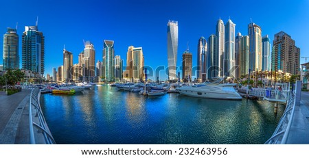 DUBAI, UAE - OCTOBER 14: Modern buildings in Dubai Marina, Dubai, UAE. In the city of artificial channel length of 3 kilometers along the Persian Gulf, taken on 14 October 2014 in Dubai. - stock photo