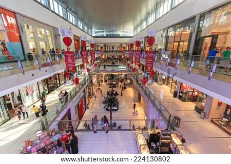 DUBAI, UAE - October 07, 2014: Shoppers at Dubai Mall in Dubai, United Arab Emirates. Dubai Mall is one of the largest mall in the world. - stock photo