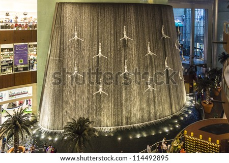 DUBAI, UAE - OCTOBER 1: Waterfall in Dubai Mall - world's largest shopping mall based on total area and sixth largest by gross leasable area, October 1, 2012 in Dubai, United Arab Emirates.