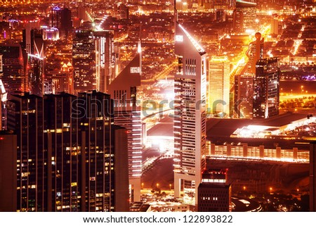 DUBAI, UAE - SEPTEMBER 27: Jumeirah Emirates Towers, which rise to 355 m and 309 m, located on the Sheikh Zayed Road, night scene on September 27, 2012 in Dubai, United Arab Emirates - stock photo