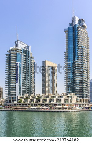 DUBAI, UAE - SEPTEMBER 29, 2012: Modern architecture in Dubai Marina - one of expensive township and most attractive tourist spot. Dubai Marina is an artificial canal city along Persian Gulf shoreline - stock photo