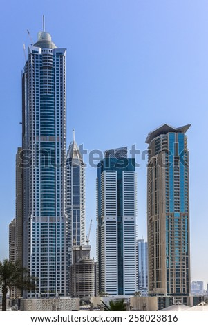 DUBAI, UAE - SEPTEMBER 30, 2012: Modern skyscrapers in Dubai (emirate and city). Dubai now boasts more completed skyscrapers higher than 0,8 - 0,25 km than any other city. United Arab Emirates. - stock photo