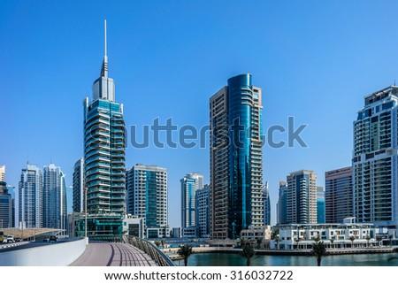 DUBAI, UAE - SEPTEMBER 8, 2015: Modern skyscrapers in Dubai Marina. Marina - artificial canal city, carved along a 3 km stretch of Persian Gulf shoreline. - stock photo
