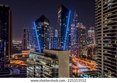 DUBAI, UAE - SEPTEMBER 29, 2012: Night view at modern skyscrapers in Dubai Marina. United Arab Emirates. Dubai Marina - artificial canal city, carved along a 3 km stretch of Persian Gulf shoreline.  - stock photo