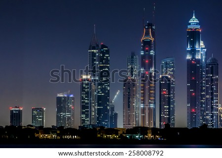 DUBAI, UAE - SEPTEMBER 29, 2012: Night view of Dubai Marina from Kempinski hotel (Palm Jumeirah). Dubai Marina - artificial canal city, carved along Persian Gulf shoreline. - stock photo