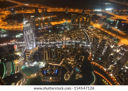 DUBAI, UAE - SEPTEMBER 10: Night view on Down town of Dubai city, on September 10, 2013, Dubai, UAE. In the city of artificial channel length of 3 kilometers along the Persian Gulf.