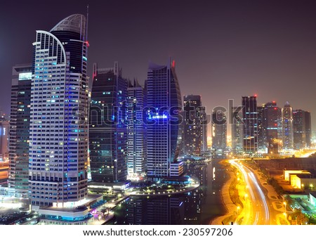 DUBAI, UAE - SEPTEMBER 30: Residential buildings in Jumeirah Lake Towers, on September 30, 2012 in Dubai, UAE. The JLT is a large development which consists of 79 towers with 4 artificial lakes.