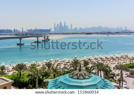 DUBAI, UAE - SEPTEMBER 30: 5-star Hotel Atlantis (1,539 spacious guest rooms including 166 suites) on man-made island of Palm Jumeirah at September 30, 2012 in Dubai, United Arab Emirates. Beach. - stock photo