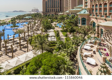 DUBAI, UAE - SEPTEMBER 30: 5-star Hotel Atlantis (1,539 spacious guest rooms including 166 suites) on man-made island of Palm Jumeirah at September 30, 2012 in Dubai, United Arab Emirates. Pool, Beach - stock photo