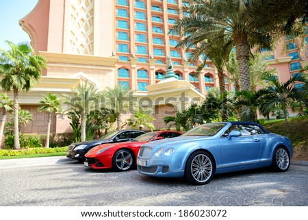 DUBAI, UAE - SEPTEMBER 11: The Atlantis the Palm hotel and limousines. It is located on man-made island Palm Jumeirah on September 11, 2013 in Dubai, United Arab Emirates - stock photo
