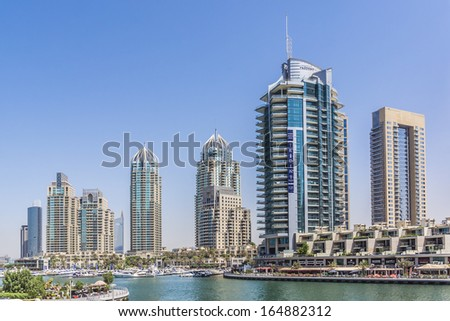 DUBAI, UAE - SEPTEMBER 29, 2012: View at Dubai Marina and man-made island of Palm Jumeirah. Dubai Marina - artificial canal city, carved along Persian Gulf shoreline. United Arab Emirates. - stock photo