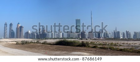 DUBAI, UAE - SEPTEMBER 26: View at Sheikh Zayed Road skyscrapers in Dubai, UAE  on September 26, 2011. More than 25 skyscrapers taller than 100 meters can be found there. - stock photo