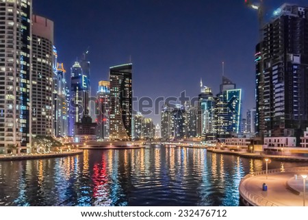 DUBAI, UAE - SEPTEMBER 29, 2012: Wonderful Night view of Dubai Marina. Marina - a district of Dubai along artificial canal, carved along a 3 km stretch of Persian Gulf shoreline. United Arab Emirates.