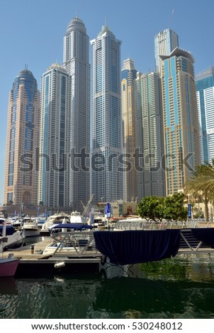 Dubai, United Arab Emirates - August 14: Dubai Marina is one of the districts of Dubai and an artificial canal city, built along the Persian Gulf shoreline. - August 14, 2014. Dubai, UAE.