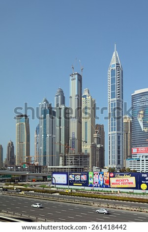 DUBAI, UNITED ARAB EMIRATES, - FEB 05, 2014: Cityscape, view of the road and modern skyscrapers - stock photo