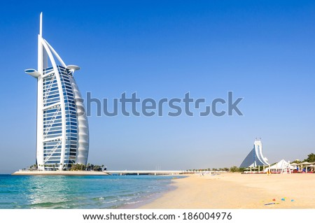 Dubai, United Arab Emirates - January 08, 2012: View of Burj Al Arab hotel from the Jumeirah beach. Burj Al Arab is one of the Dubai landmark, and one of the world's most luxurious hotels with 7 stars - stock photo