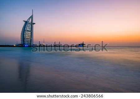 DUBAI, UNITED ARAB EMIRATES - MAY 20, 2013: Burj al-Arab in the evening from Jumeirah Beach, Dubai - stock photo