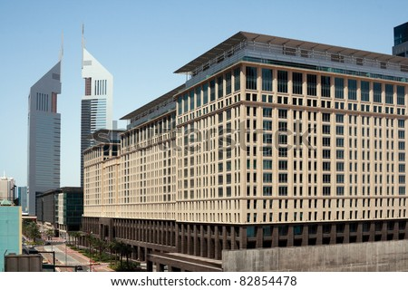DUBAI, UNITED ARAB EMIRATES - MAY 18: The Ritz-Carlton Hotel and the Emirates Towers as a parts of International Financial Centre on May 18, 2011 in Dubai, UAE. The Centre was designed by Eric Kuhne.