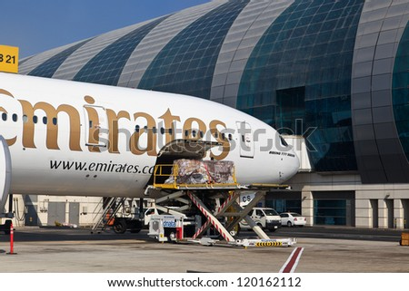 DUBAI, UNITED ARAB EMIRATES - NOVEMBER 10: Emirates Boeing 777 loaded at Dubai Airport on November 10, 2012 in Dubai, UAE. Emirates is rated as top 10 best world airline flying on youngest fleet - stock photo