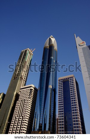 DUBAI, UNITED ARAB EMIRATES - NOVEMBER 17: View at Sheikh Zayed Road skyscrapers in Dubai on November 17, 2010. More than 25 skyscrapers taller than 100 meters can be found here. - stock photo